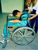 Eli in his wheelchair before special seating