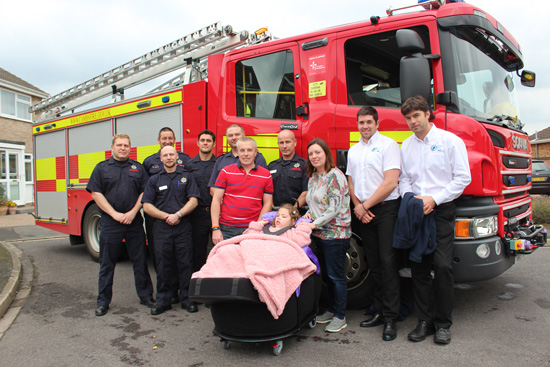 Firefighters from Dogthorpe Fire Station, SOS Community Specialists, Effie Hadman and Family