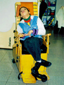 Selenia in her wheelchair before special seating