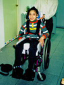 Selenia in her wheelchair after special seating