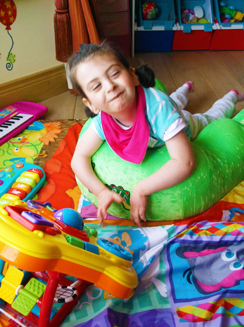 Claire Kiely enjoying playtime in her Nessie Positioning Aid