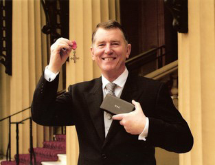 Gordon McQuilton with his MBE awarded for services in special seating for disabled children and adults.