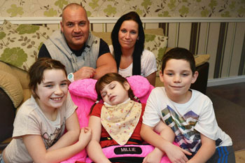 Millie Mann fast asleep in her PPod with her family, Remembering Rebecca Donation from SOS