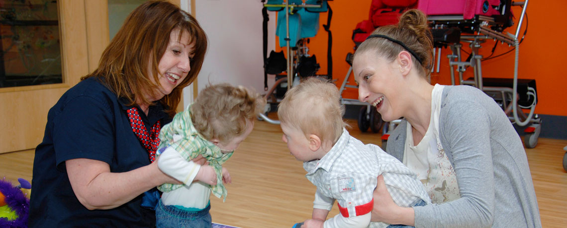 Photo of Daitton and Eithan playing at the Specialised Orthotic Services Coffee Morning