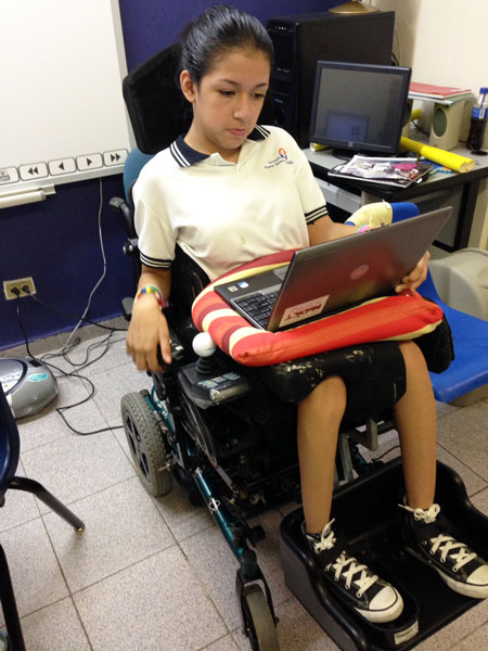 student-using-laptop-power-wheelchair