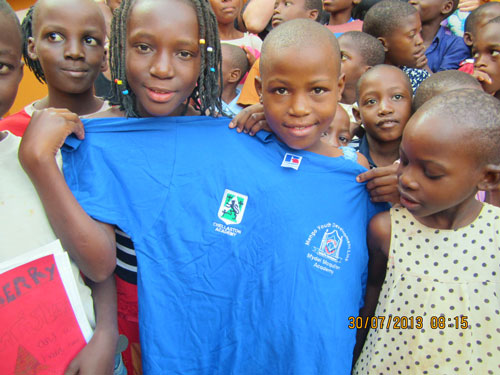 Students from the Mydel Academy looking pleased with their new school uniforms