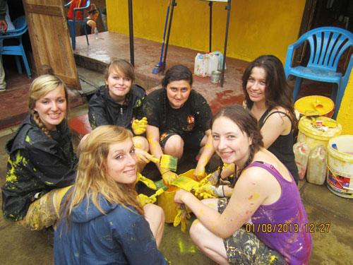 Chellaston School Tigger Team volunteers painting the Mydel Academy
