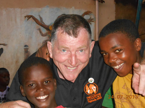 Gordon McQuilton with some of the orphans in Uganda